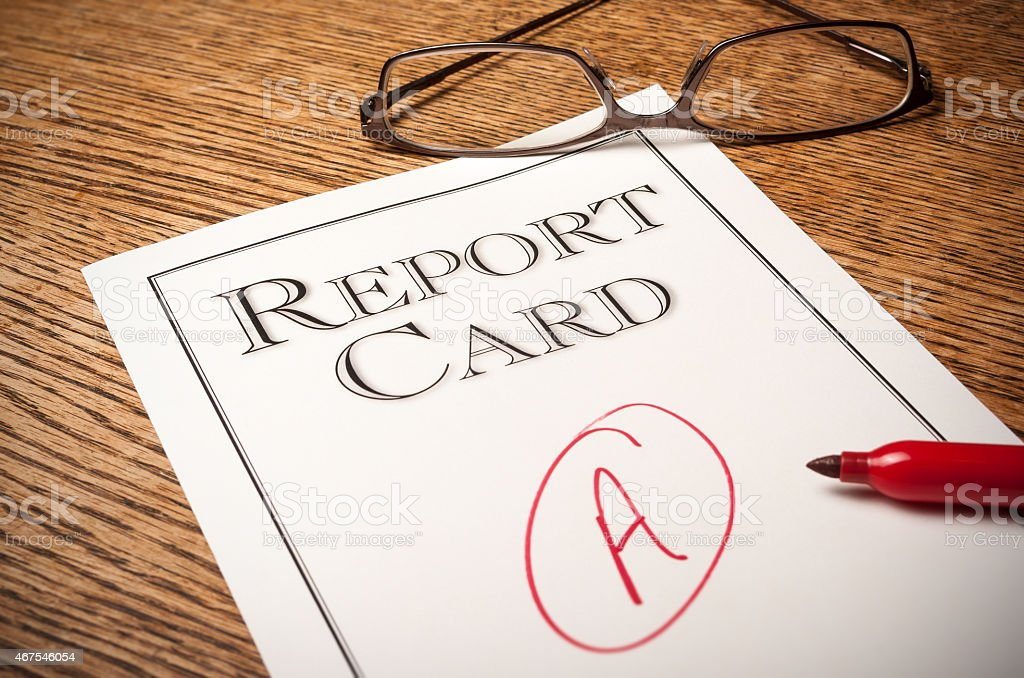 Report card on a desk stock photo