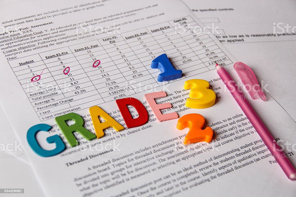 Report card with red marker pen stock photo