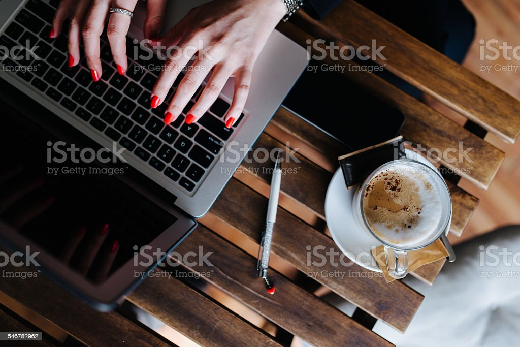 Report typing on a coffee break stock photo