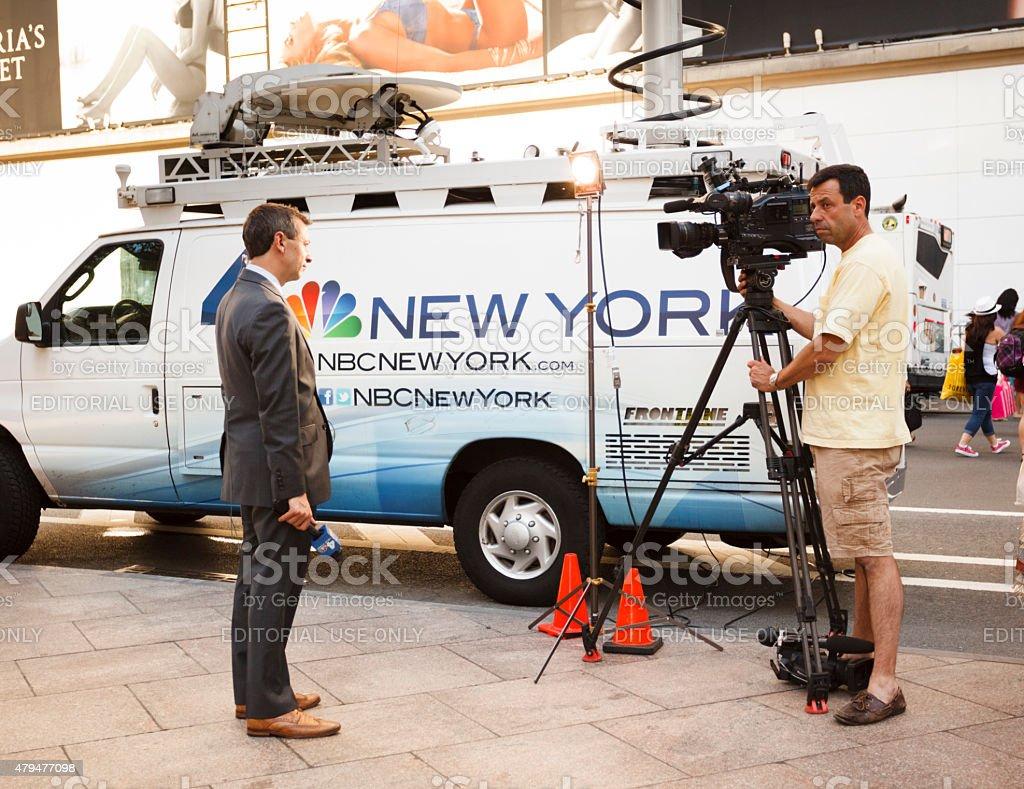 NBC Reporter and Camera Man with News Van stock photo