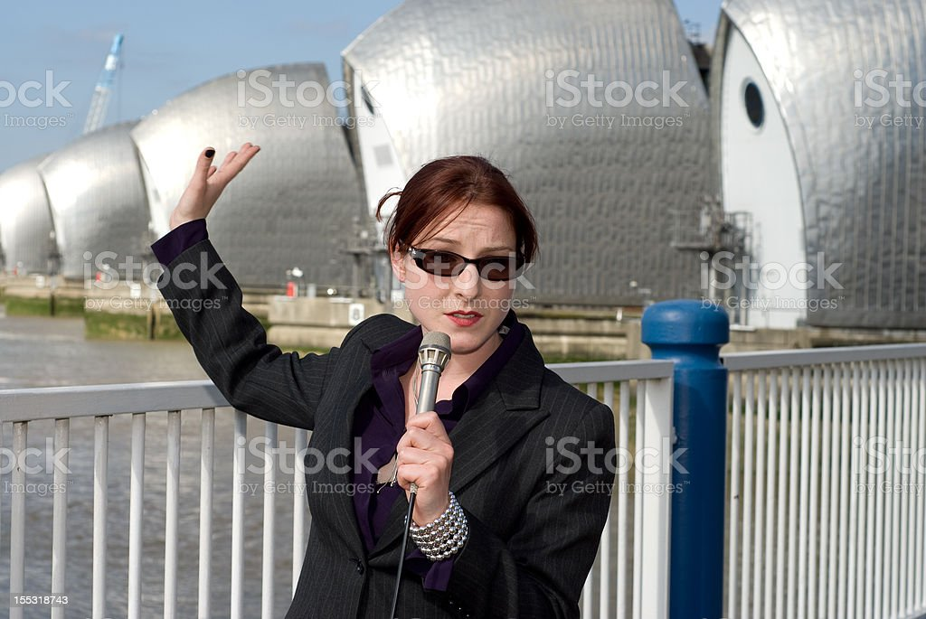 TV reporter by river stock photo