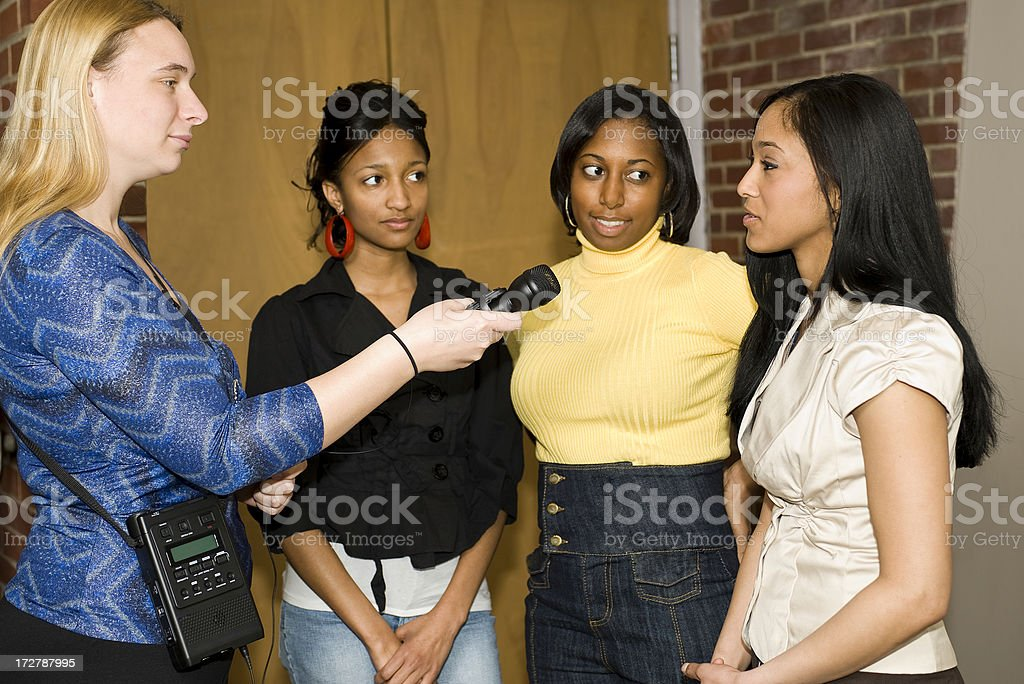 Reporter conducting an interview royalty-free stock photo