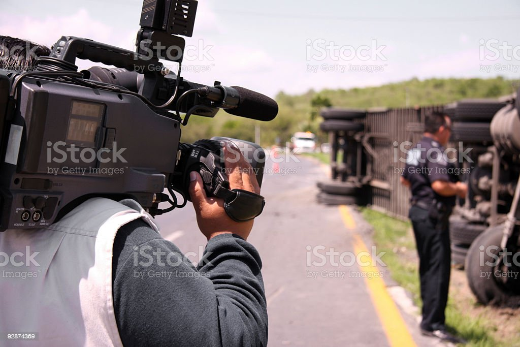 Reporter on accident action stock photo