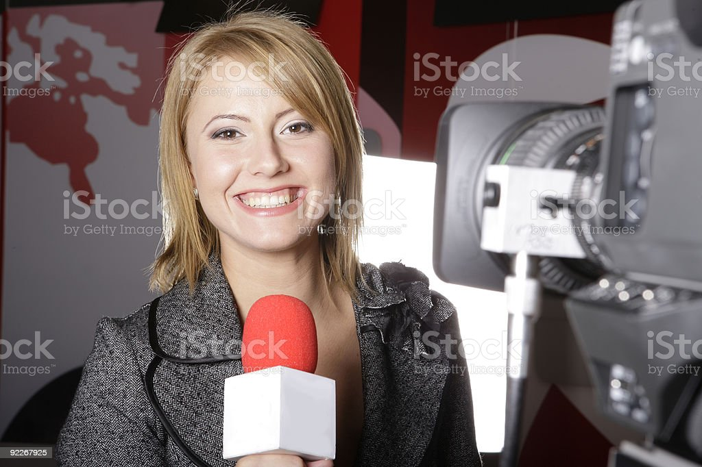 TV reporter ON THE AIR stock photo