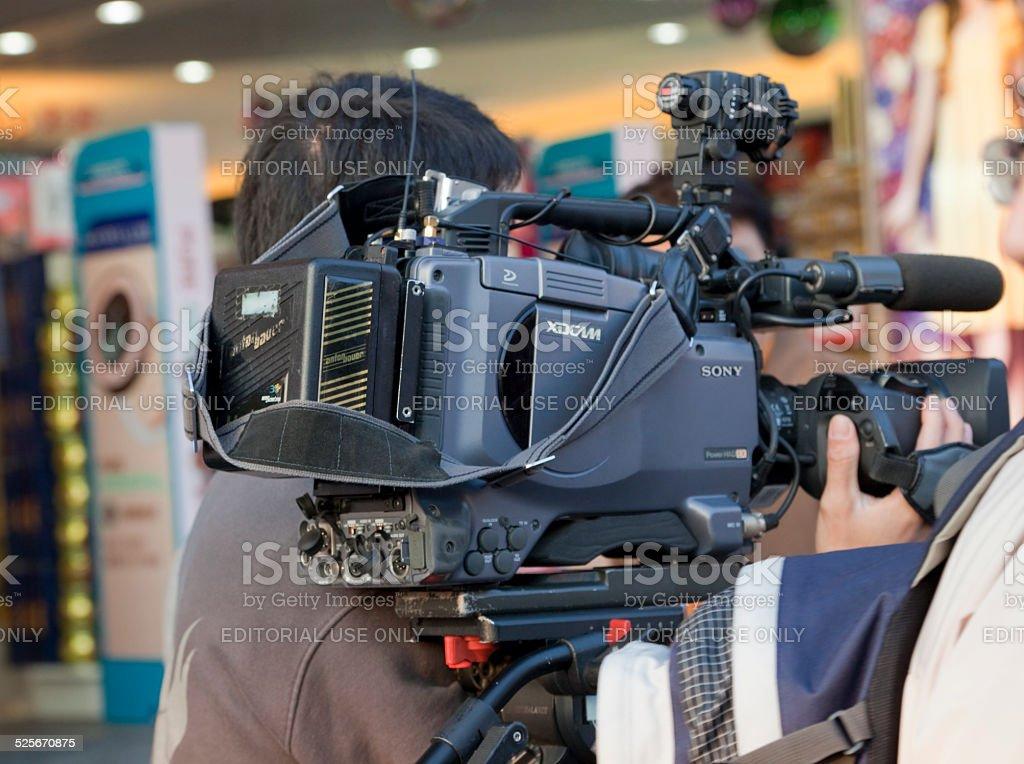 TV Reporter shooting in Hong Kong stock photo
