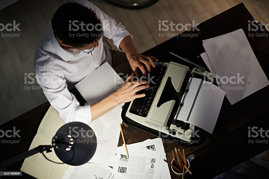 Reporter working late stock photo