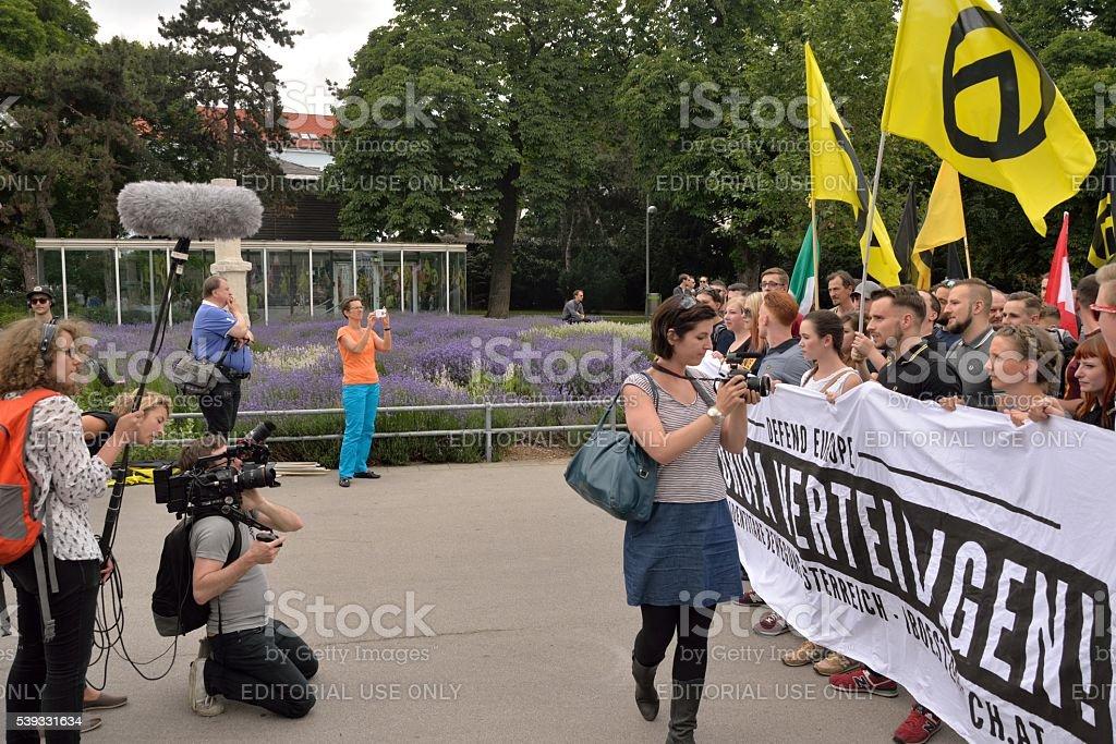 Reporters in front demonstrators stock photo