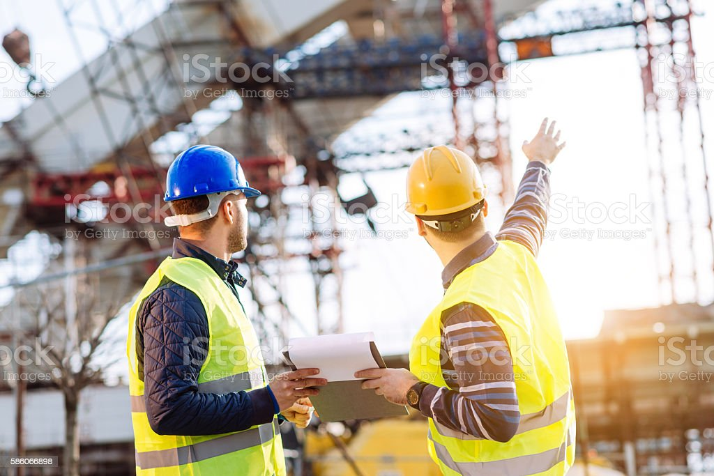 Reporting to contractor at construction site stock photo