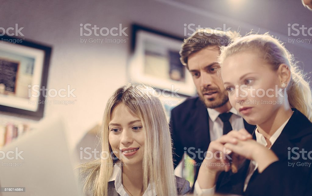 Reports being Viewed on a Laptop stock photo