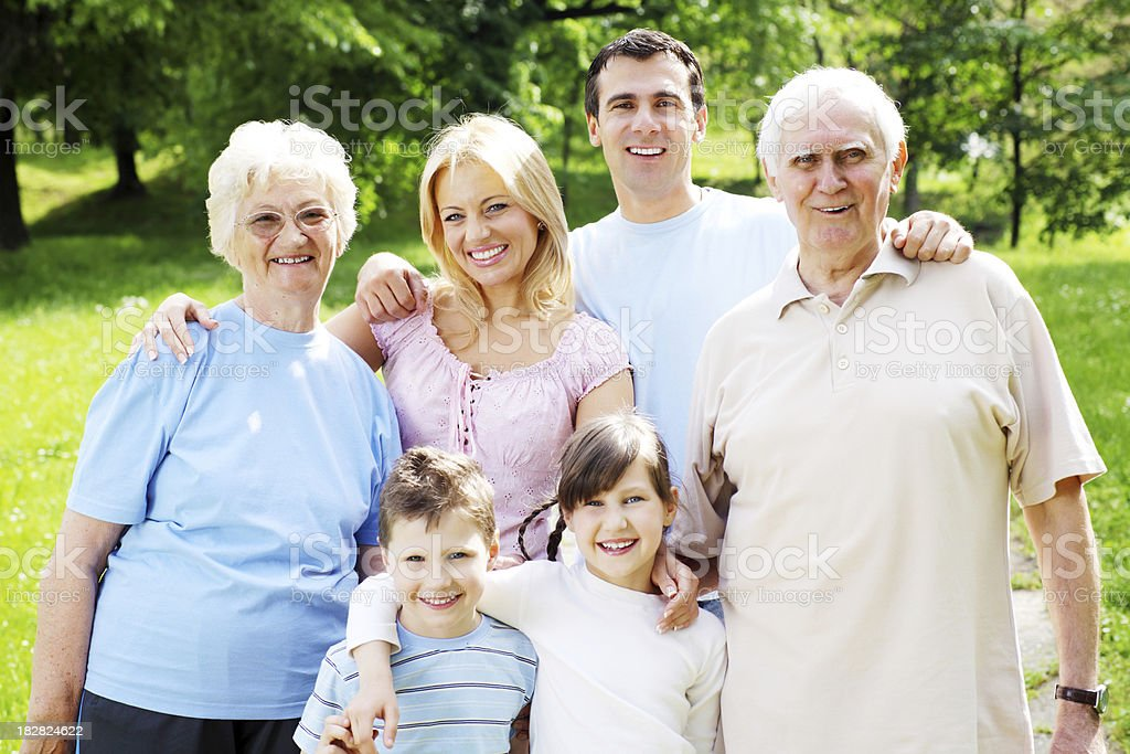 Representative portrait of extended family in the park. royalty-free stock photo