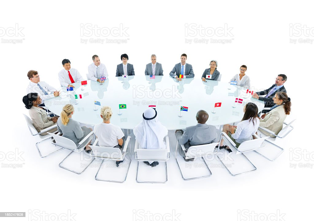 Representatives at round table for international conference stock photo