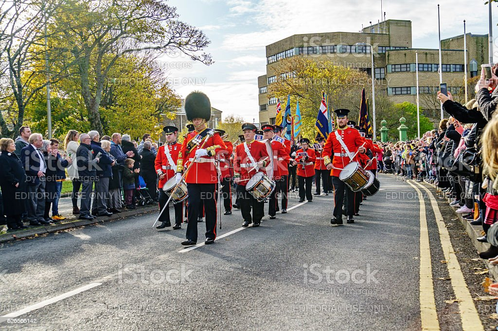 Representatives of the armed forces marching through town stock photo