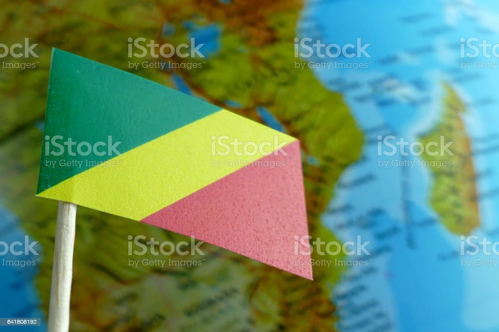 Republic of Congo flag with a globe map as background stock photo