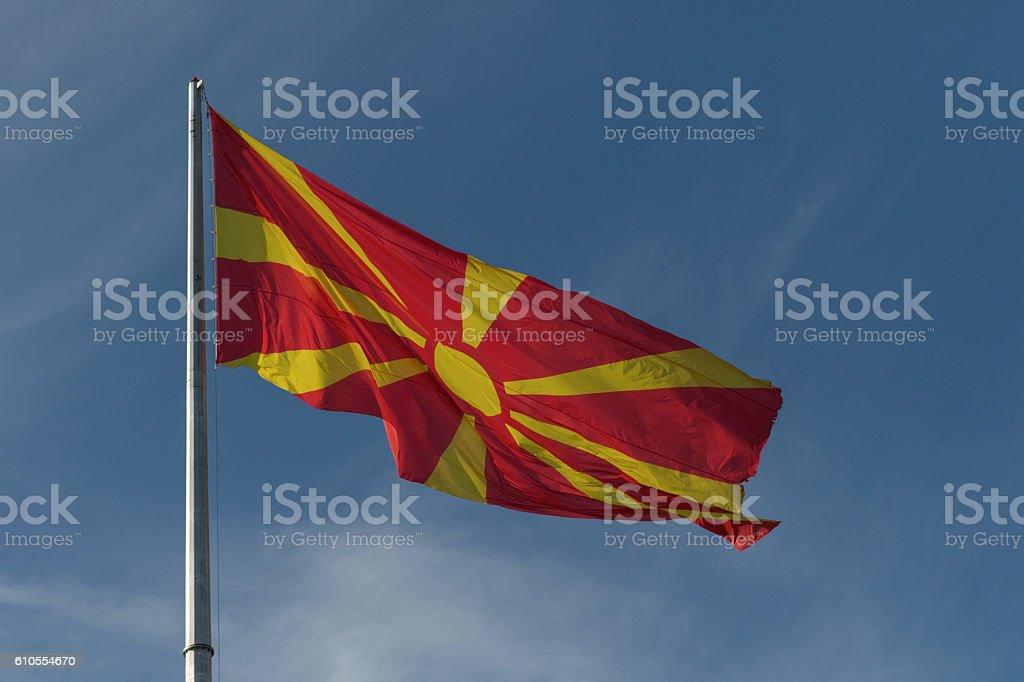 Republic of Macedonia flag on the mast stock photo