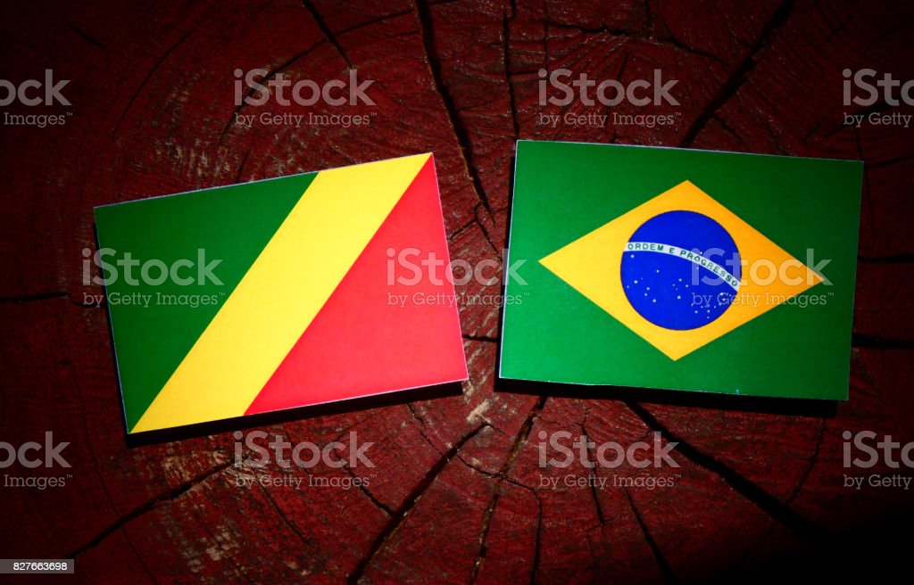 Republic of the Congo flag with Brazilian flag on a tree stump isolated stock photo