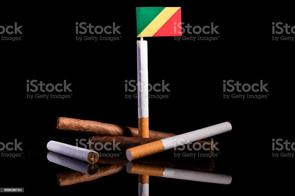 Republic of the Congo flag with cigarettes and cigars. Tobacco Industry concept. stock photo
