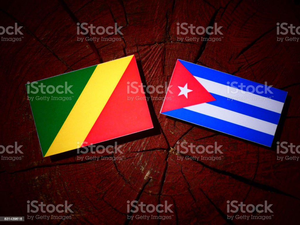 Republic of the Congo flag with Cuban flag on a tree stump isolated stock photo