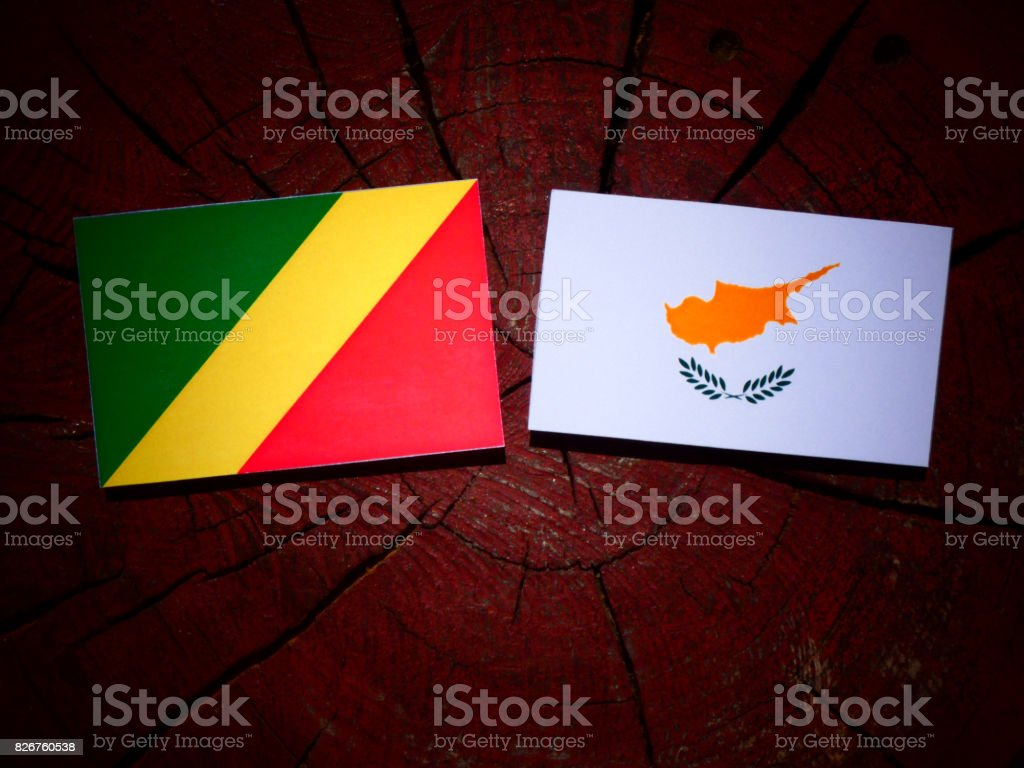 Republic of the Congo flag with Cypriot flag on a tree stump isolated stock photo