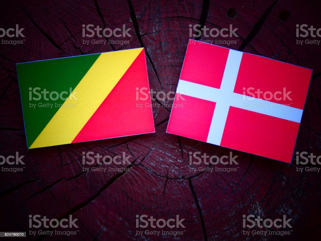 Republic of the Congo flag with Danish flag on a tree stump isolated stock photo