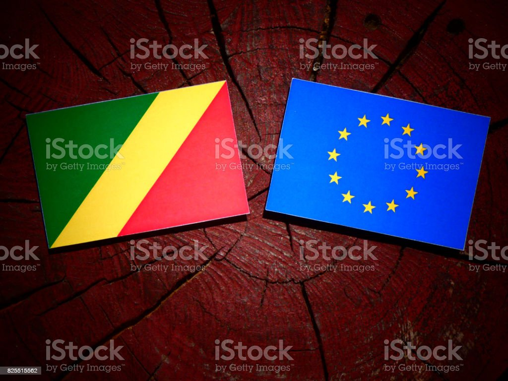 Republic of the Congo flag with EU flag on a tree stump isolated stock photo