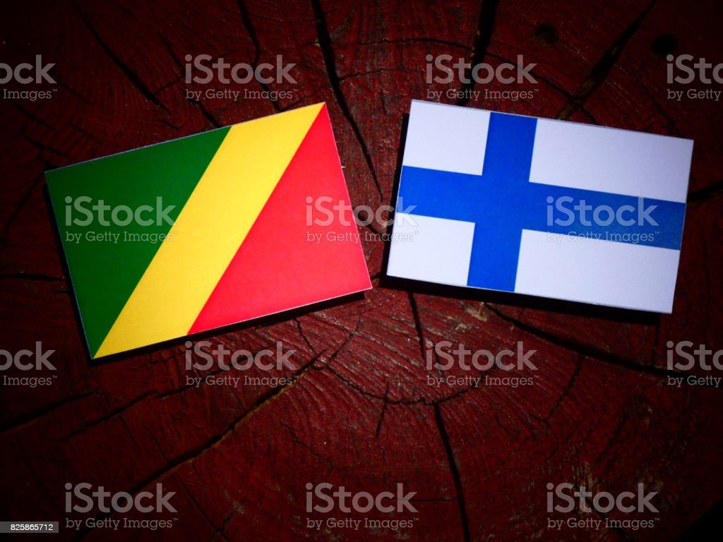 Republic of the Congo flag with Finnish flag on a tree stump isolated stock photo