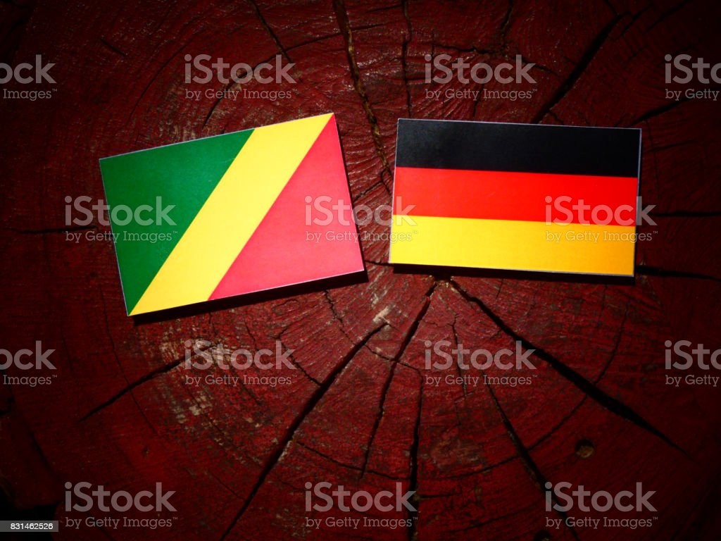 Republic of the Congo flag with German flag on a tree stump isolated stock photo