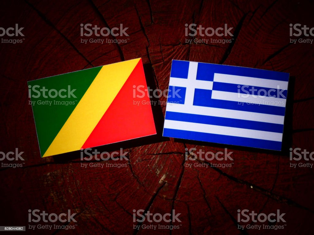Republic of the Congo flag with Greek flag on a tree stump isolated stock photo