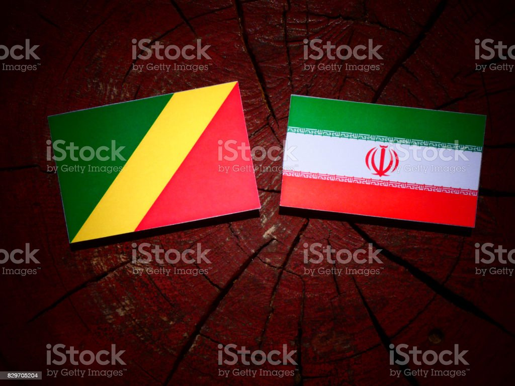 Republic of the Congo flag with Iranian flag on a tree stump isolated stock photo