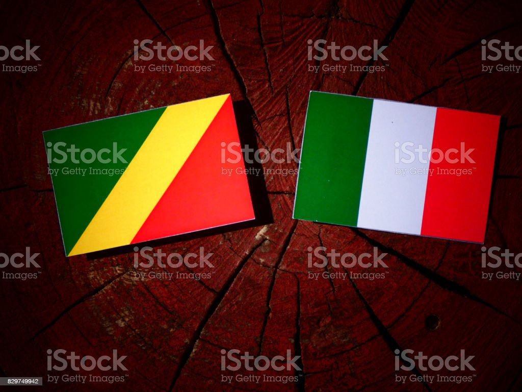 Republic of the Congo flag with Italian flag on a tree stump isolated stock photo