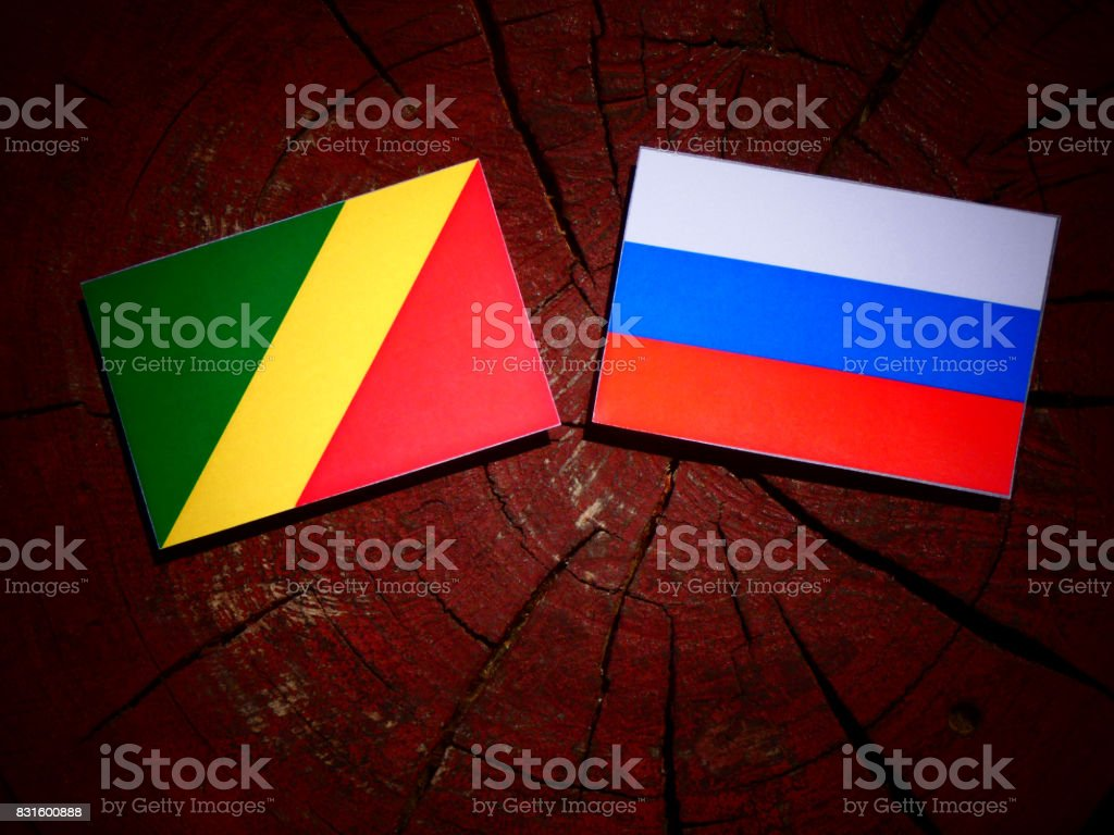 Republic of the Congo flag with Russian flag on a tree stump isolated stock photo