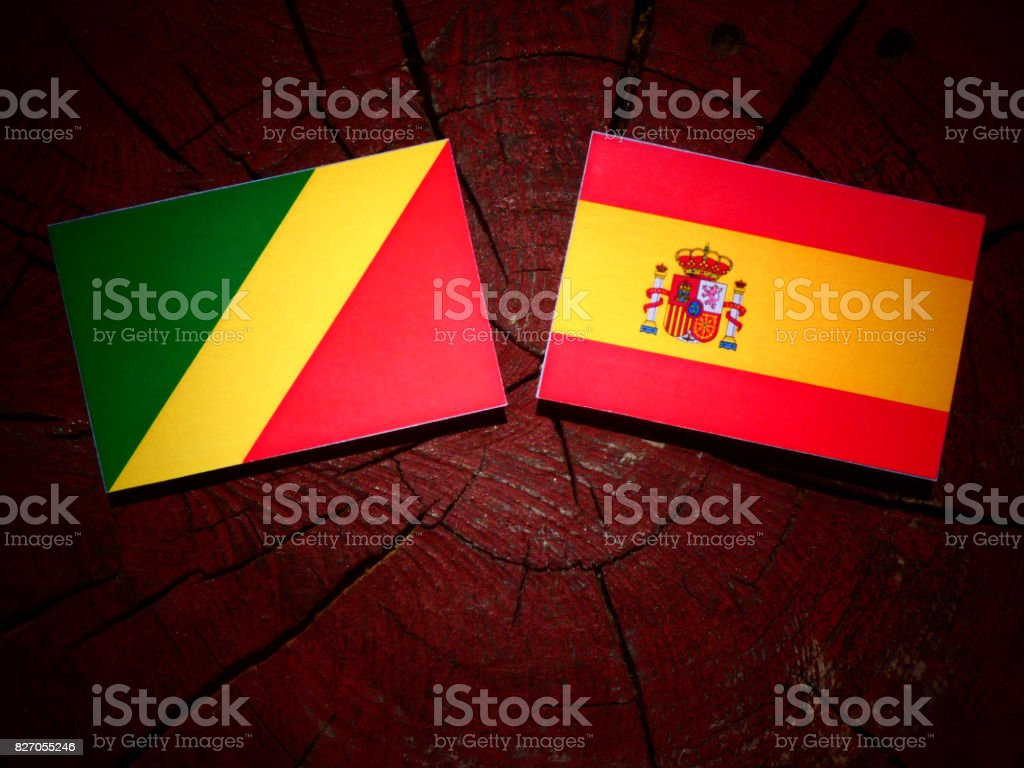 Republic of the Congo flag with Spanish flag on a tree stump isolated stock photo