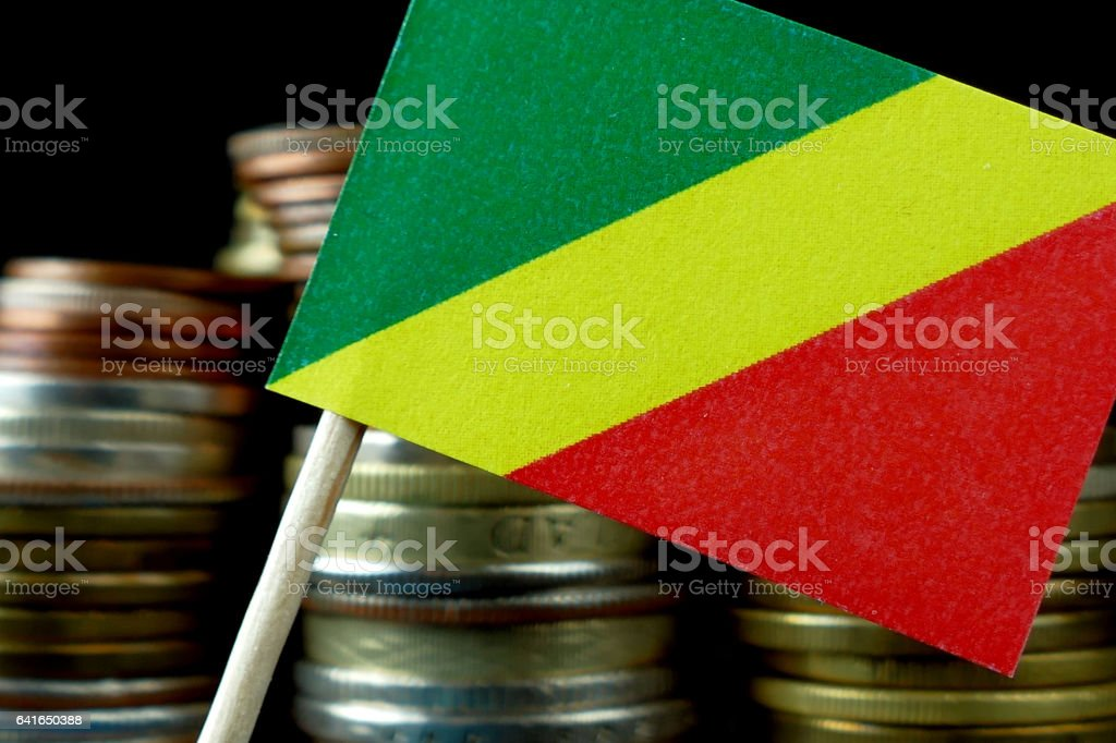 Republic of the Congo flag with stack of money coins stock photo