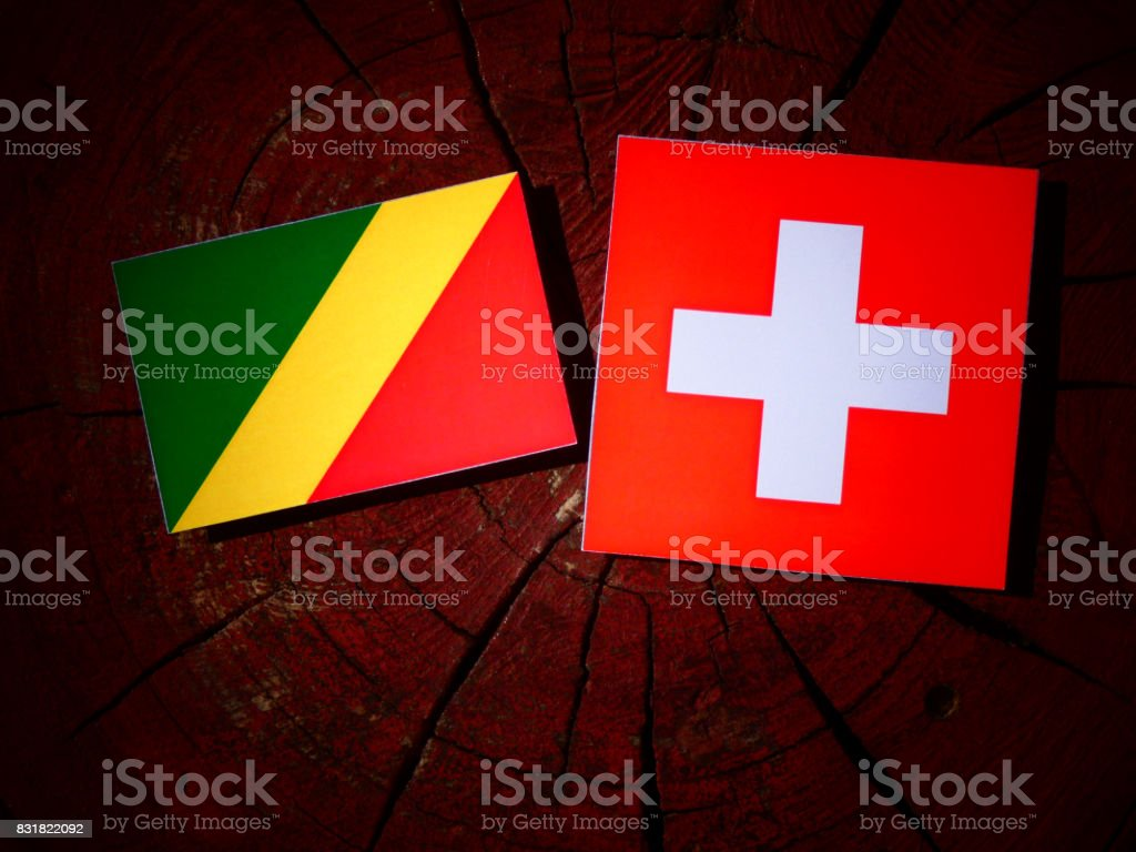 Republic of the Congo flag with Swiss flag on a tree stump isolated stock photo