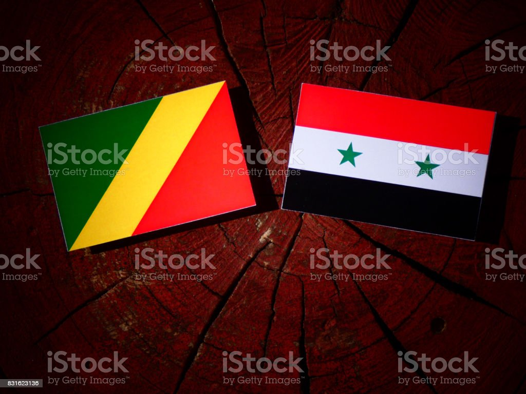 Republic of the Congo flag with Syrian flag on a tree stump isolated stock photo
