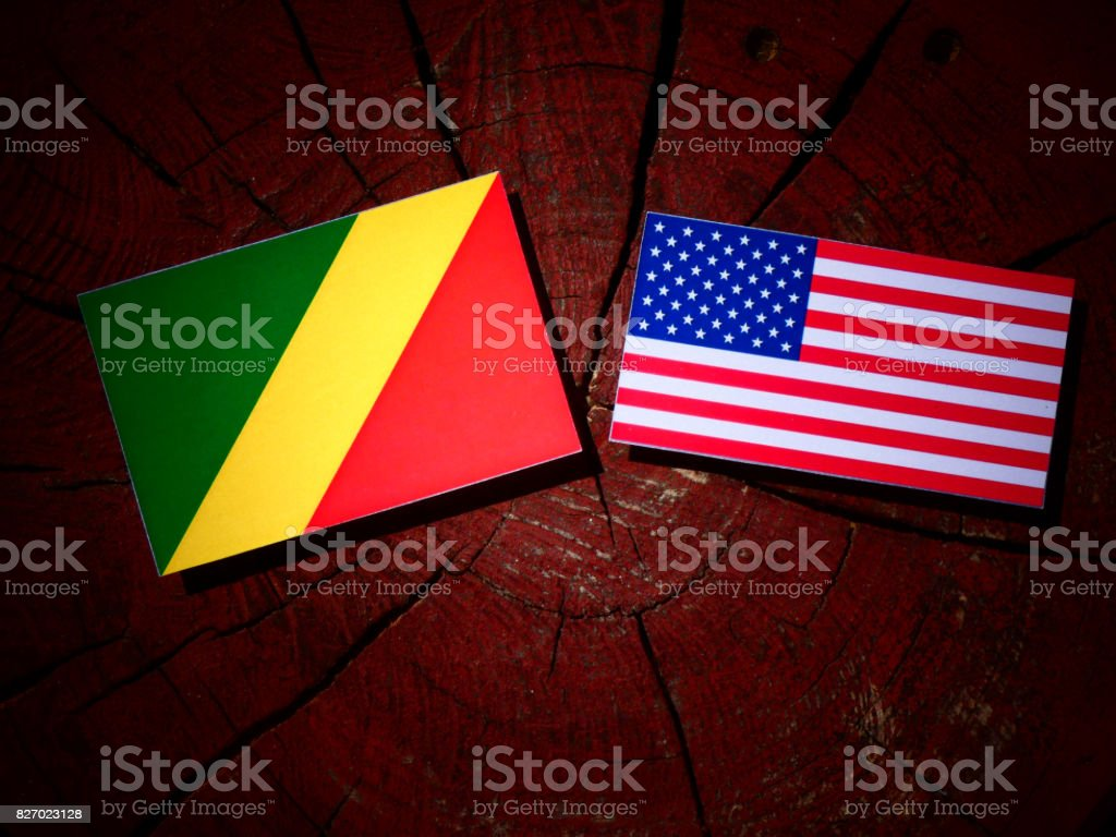 Republic of the Congo flag with USA flag on a tree stump isolated stock photo