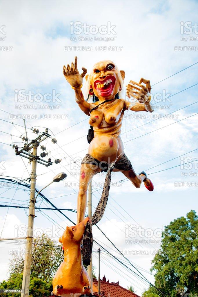 Repulsive Ogoh-Ogoh statue running during Nyepi Ngrupuk parade stock photo