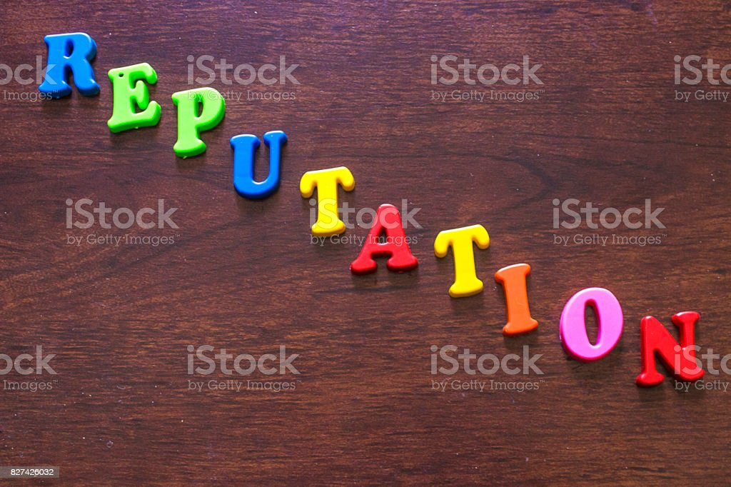 reputation colorful letters on wood background stock photo