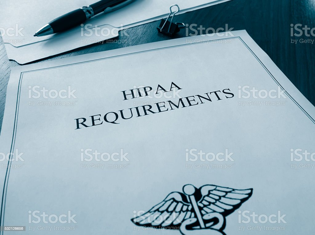 HIPAA Requirements documents stock photo