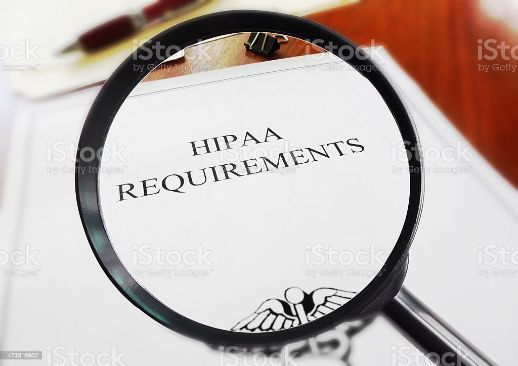 HIPAA requirements seen through a magnifying glass stock photo