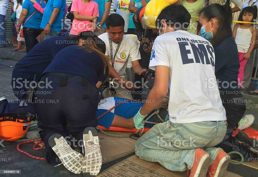 Rescue and medic help to men stock photo