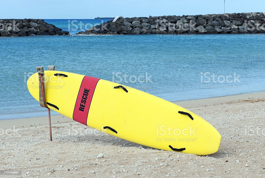 Rescue board for lifeguard at water's edge in Honolulu royalty-free stock photo
