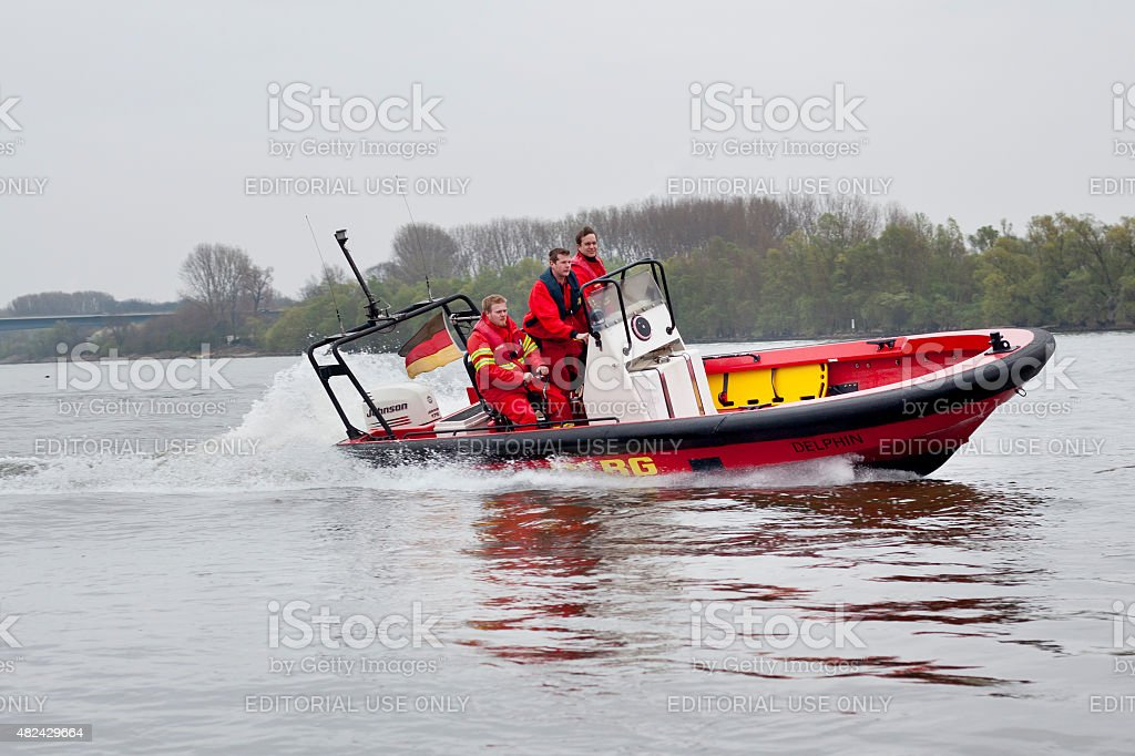 Rescue boat and Lifeguards of DLRG Wasserrettung stock photo
