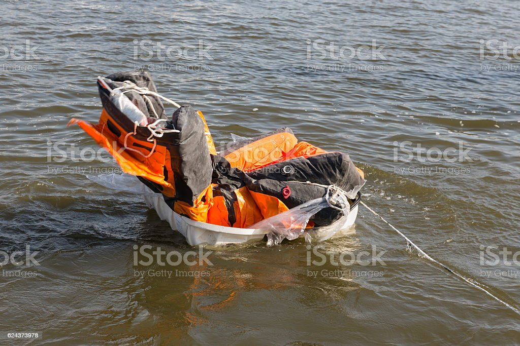 Rescue demonstration life raft opening in the water stock photo