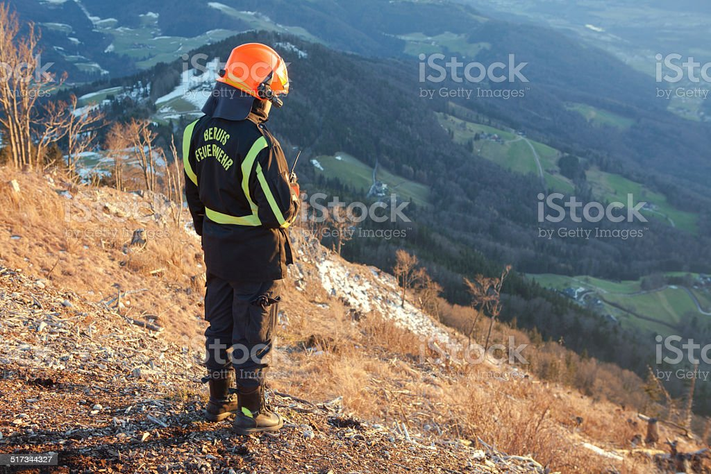 Rescue Fire worker in the Mountain stock photo