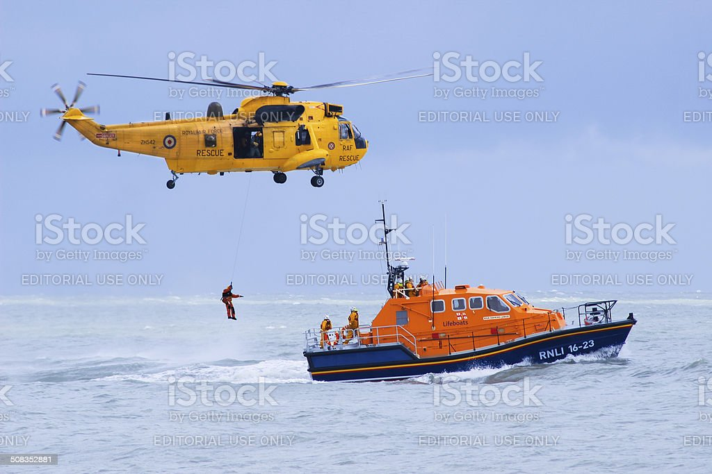 RAF Rescue helicopter and RNLI rescue boat in action stock photo