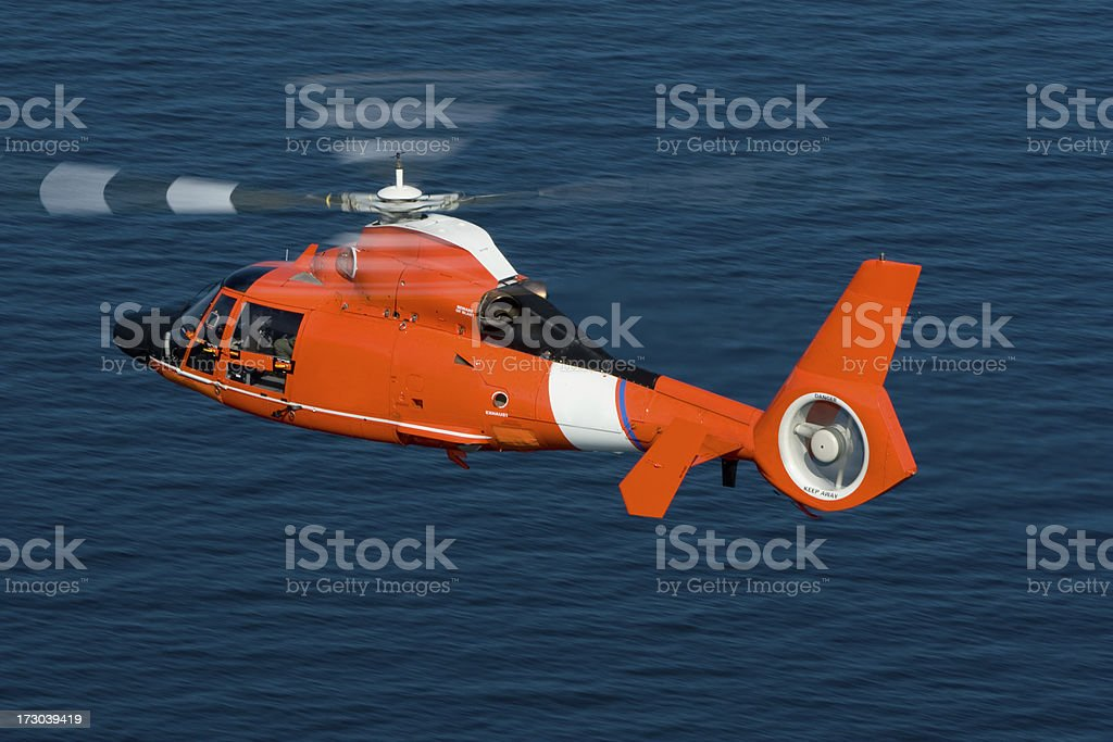 Rescue helicopter in action at sea  stock photo