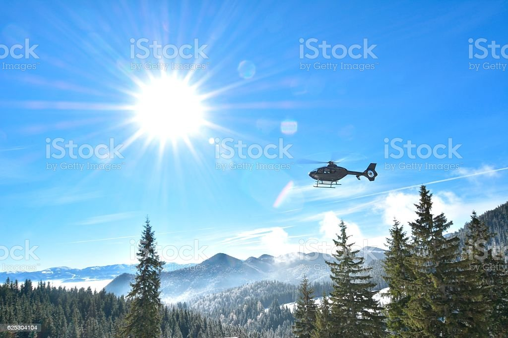 Rescue helicopter in mountains stock photo