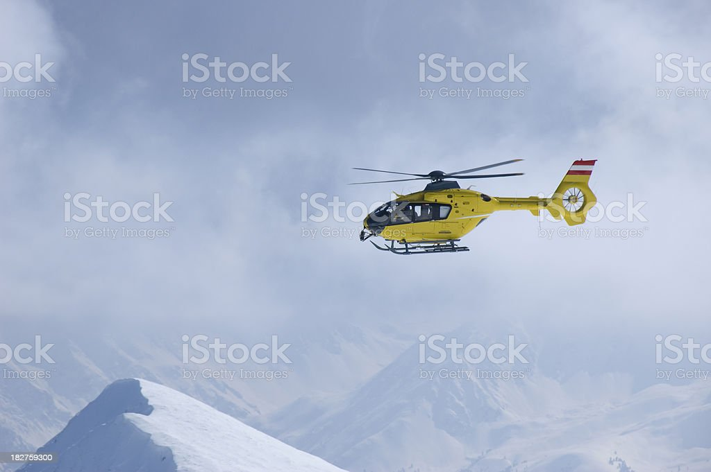 rescue helicopter in the alps stock photo