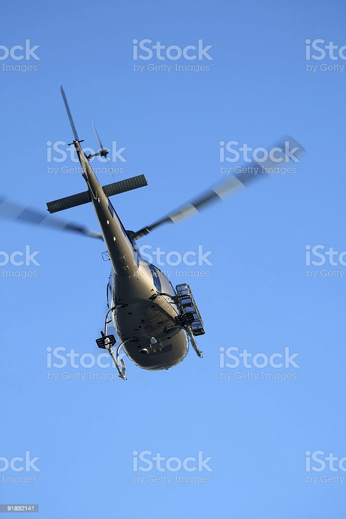 Rescue Helicopter In The Cloudless Sky stock photo