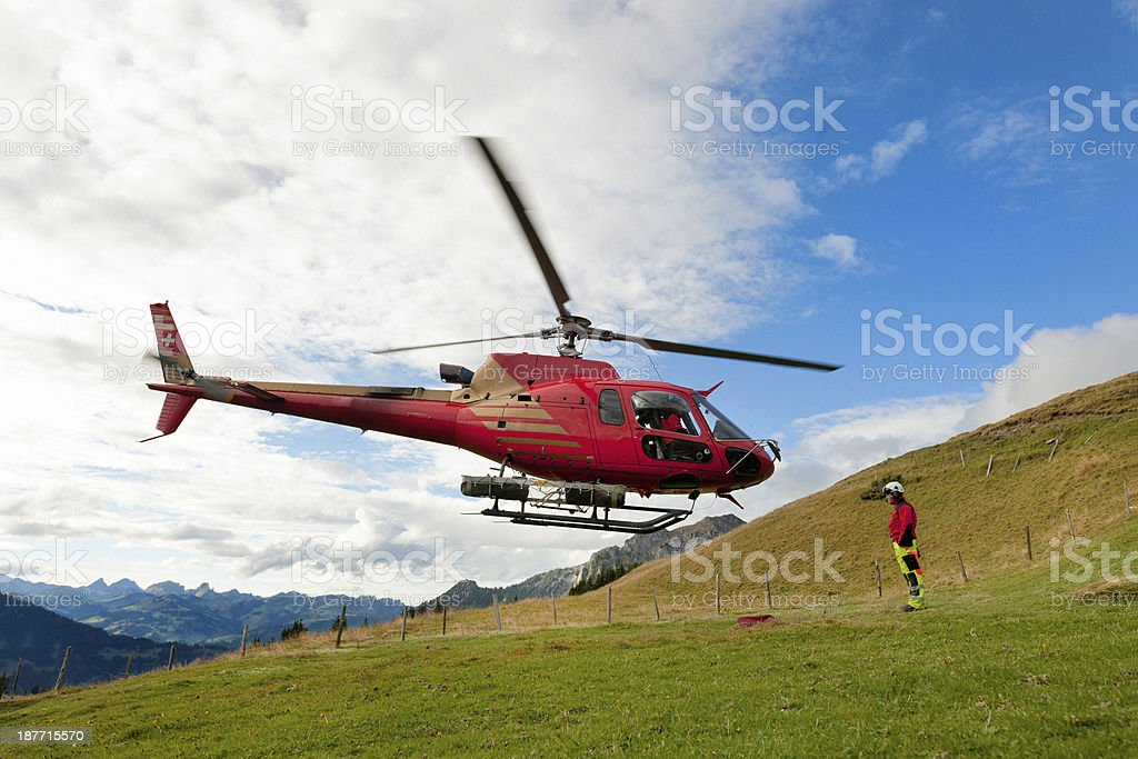 rescue helicopter taking off from mountain royalty-free stock photo
